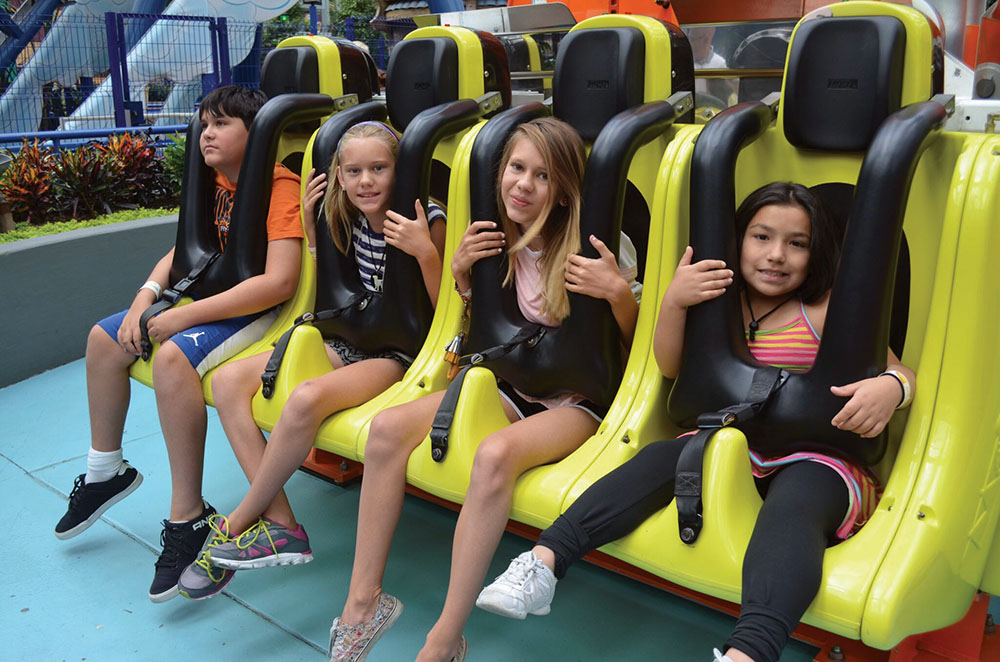 kids enjoying amusement park ride at convention